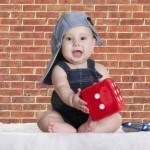 Cute Baby with a Brick Background