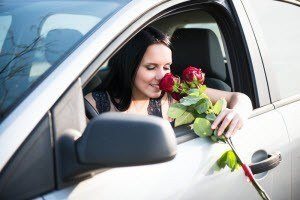Smelling-Roses-Outside-Car